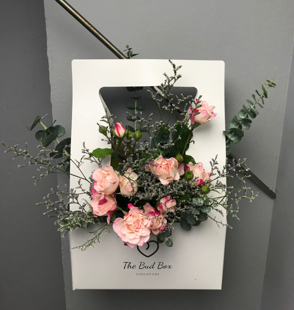 Flowers in a box pink rose spray