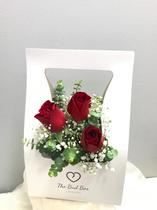 3 red rose and baby breaths in flower box